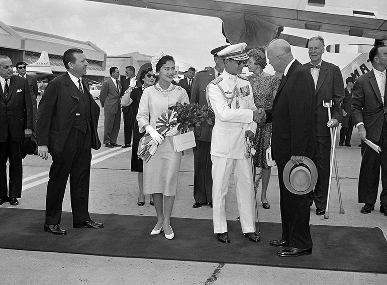 King Bhumibol Adulyadej and Queen Sirikit of Thailand meet with u.S. President Dwight D. Eisenhower at Washington, D.C.'s National Airport on June 28, 1960.